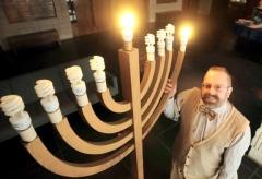 Rabbi Swartz lights his congregation's CFL menorah.